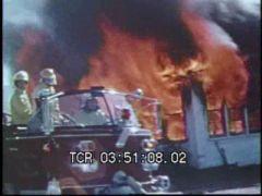 Thumbnail of Firemen Attack House Fire